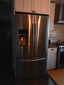 Stainless steel Samsung refrigerator with water/ice machine