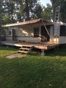 House trailer. Deck and Shed. Any reasonable offer considered.