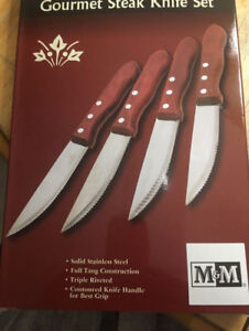 steak knifes ,brand new,sealed boxes ,four in the box,25 boxes