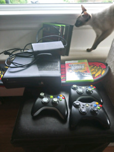 Xbox 360s with 5 games 3 controllers. Skateboard.