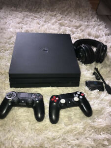 Ps4 pro like new with 2 controller headset and battery pak cheap