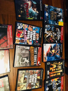PS2 + 2 controllers + memory card + games