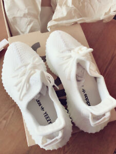 Brand new yeezy 350 triple white men size 6 , women fit 35-36