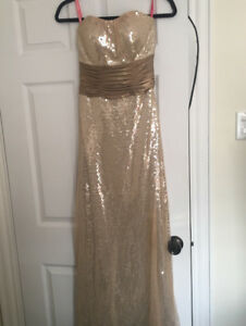 Gold sequinned strapless prom dress
