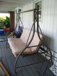 brown metal porch/deck swing