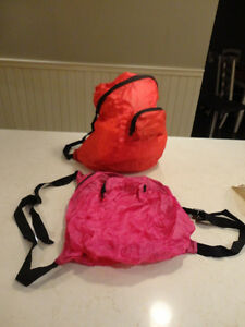 "2 New Nylon Folding back packs Folds tightly into a 4x4x1"" Pouch"
