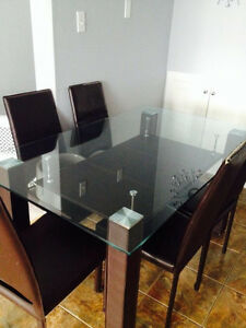 Glass dinning table- free chairs