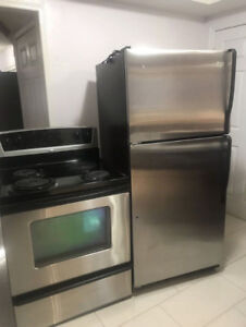 Whirlpool stainless steel fridge and stainless steel stove set