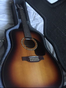 Barely Used 12-String Simon and Patrick Songsmith Guitar