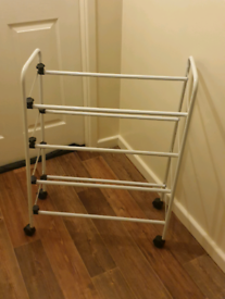 White metal extendable shoe rack stand