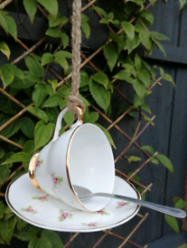 DECORATIVE BIRD FEEDER MADE FROM A VINTAGE TEACUP AND SAUCER