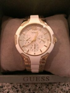 Woman's Gold Tone Guess Watch