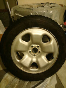 225/60R17 Firestone Winterforce with rims. 5 bolt, used 1 season