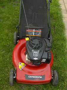 GAS lawn mowers nearly new and used in good condition