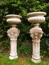 Pair of large stone urns and plinths