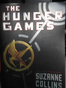 The Hunger Games by Suzanne Collins - soft cover book