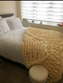 Chunky large knitted throw