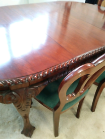 Ornate solid wood extending dining table - includes 6 chairs