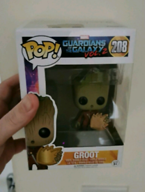 Funko pop vinyl Baby Groot with shield.