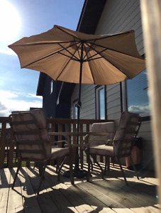 Patio furniture with 4 cushioned chairs & umbrella