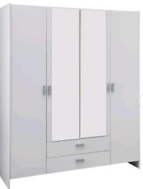 A new still boxed slight seconds white finish 4 door 2 drawer wardrobe