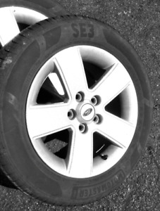 Almost new all season Tire 205/60r16 on Ford ALUMINUM wheel