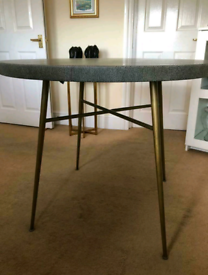 Round dining table faux animal print with gold legs