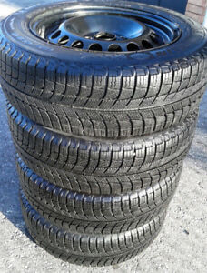 185/65/15 Michelin winter tires, 4x100,  less than 7,500 KMs
