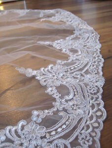 New, cathedral lace veil