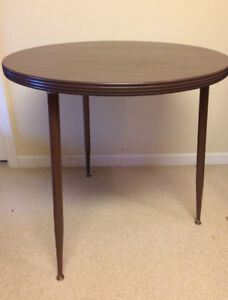 small round table, tall set of drawers, halogen floor lamp