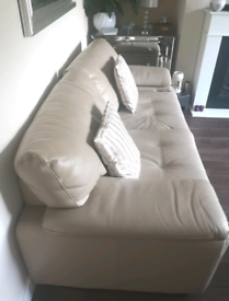 2 x 3 seater leather sofas in Taupe
