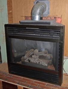 Oh the weather outside is frightful..gas fireplace for sale..