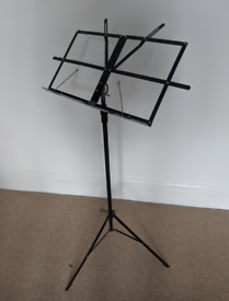 Black folding music stand for sheet music