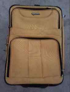Medium sized yellow Tracker luggage