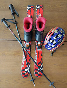 Junior skis with boots, poles, and helmet.