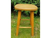 Sturdy pine vintage wooden stool with shaped legs