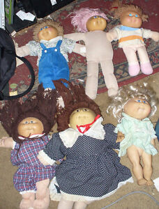 large collection of Cabbage Patch kids dolls.