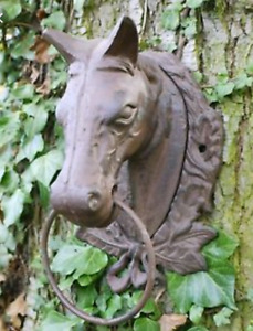 Two Cast iron horse heads ring hitching post
