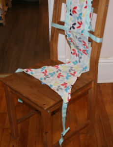 Portable 'high chair' - fabric sling mounts to any chair