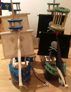 Two wooden toy pirate ships