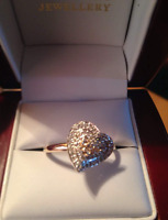 Gold ring with diamond heart