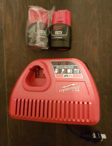 Brand Milwaukee M12 2.0ah batteries and charger