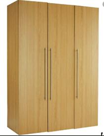 A new still boxed flat packed oak effect 3 door wardrobe.