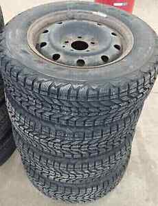 Set of 4 firestone winterforce 205/65R15 winter tires on rims