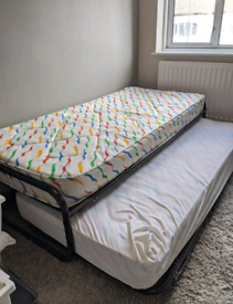 Single trundle bed with mattresses