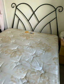 Solid double bed + mattress (delivery available