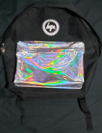 HYPE BLACK WITH HOLOGRAPHIC POCKET RUGSACK