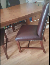 Solid wood table and six solid leather chairs