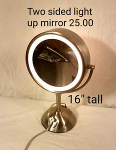 """two sided light up mirror 16"""" tall 25$"""