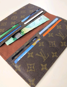Handmade repurposed into women's wallet from Louis Vuitton bag